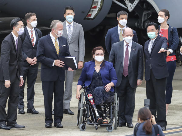 Taiwan's Foreign Minister Joseph Wu (second right) welcomes U.S. senators upon their arrival at the Songshan Airport in Taipei on Sunday. To his right are Democratic Sen. Christopher Coons of Delaware, a member of the Foreign Relations Committee, Democratic Sen. Tammy Duckworth of Illinois and Republican Sen. Dan Sullivan of Alaska, members of the Armed Services Committee.