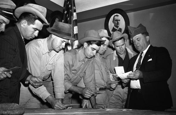 A group registers for military selective service at the state fair grounds in Dallas in 1940. The Supreme Court said Monday it would not hear a case challenging the rule that only men need to register for the draft.