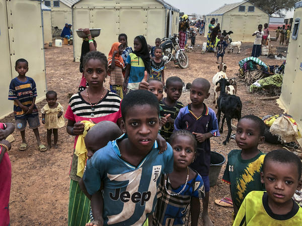 Children of about 6,000 ethnic Fulanis who have been displaced by attacks gather in a makeshift camp in Youba, Burkina Faso, in April 2020. The West African nation continues to be racked by violence linked to Islamic extremists and local defense militias.