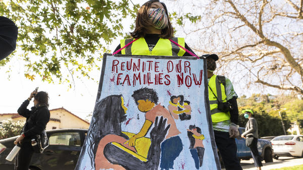 """Protesters participate March 6 in the """"Reunite Our Families Now!'' rally in Los Angeles to protest continued deportations and demand that children be reunited with their families."""