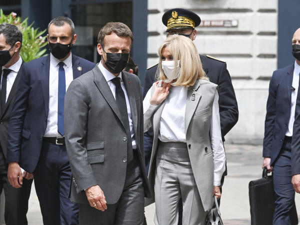 French President Emmanuel Macron and his wife, Brigitte, arrive for a lunch Tuesday in Valence, France. A man slapped the president in the face during the French leader's visit to a small town in southern France.
