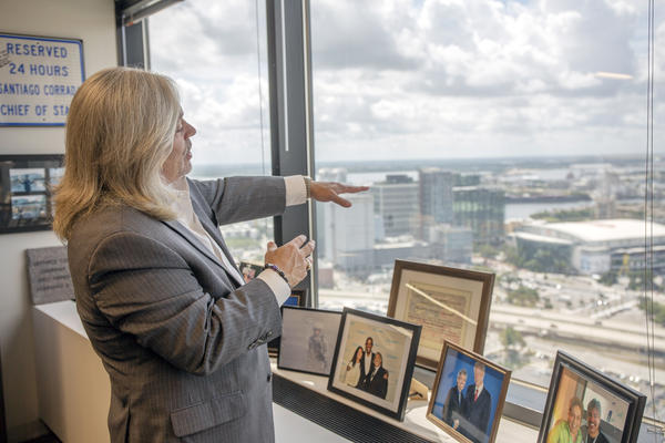 Santiago Corrada, the CEO of Visit Tampa Bay, points out his office window in downtown Tampa at tourist destinations like the cruise port, Sparkman's Warf,  Riverwalk, Amelie Arena and more.