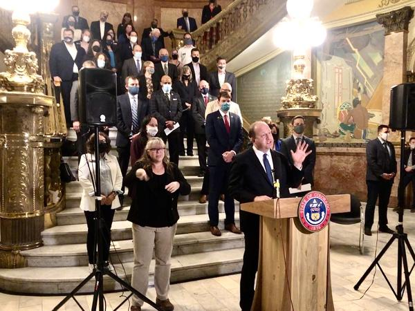 Gov. Jared Polis speaks in support of a $5.4 billion transportation proposal at the state Capitol.