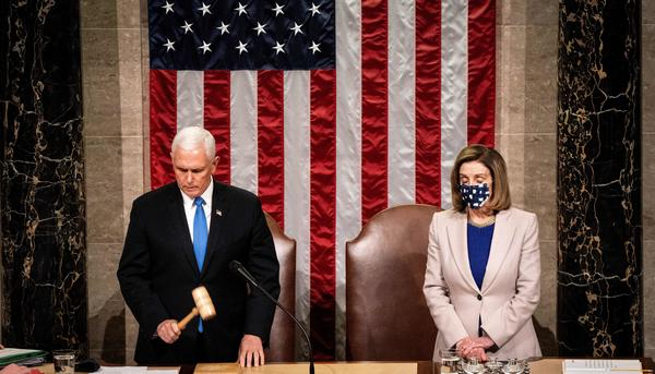 Then-Vice President Mike Pence and House Speaker Nancy Pelosi preside over a joint session of Congress on Jan. 6 to certify the 2020 Electoral College results after a pro-Trump mob stormed the Capitol earlier that day.