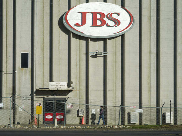 The meatpacking company JBS confirms it paid an $11 million ransom to hackers who targeted its U.S. and Australia operations.