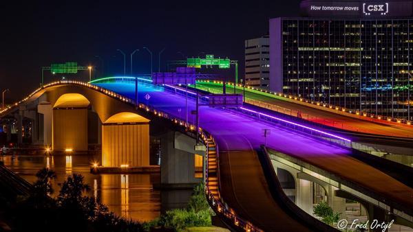 Acosta Bridge in Jacksonville lit up with rainbow colors.