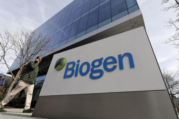 A man walks past the Biogen Inc. headquarters in Cambridge, Mass. (Steven Senne/AP)