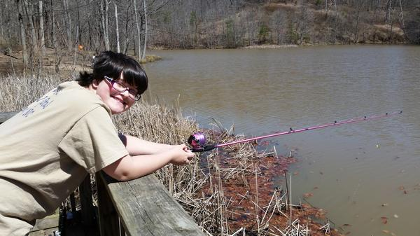 A young angler tries her luck in Wine Cellar Park lake in Dunbar, West Virginia.