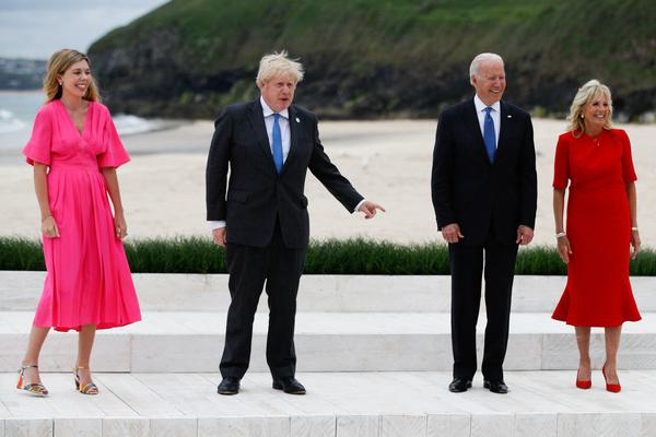 U.K. Prime Minister Boris Johnson and his wife, Carrie, meet with President Biden and first lady Jill Biden as they arrive for the G-7 summit Friday in Carbis Bay, England.