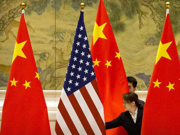 U.S. and Chinese flags before the opening session of 2019 trade negotiations between U.S. and Chinese trade representatives in Beijing. China just passed a sweeping law designed to counter sanctions the U.S. and the European Union have imposed on Chinese officials and major Chinese companies.