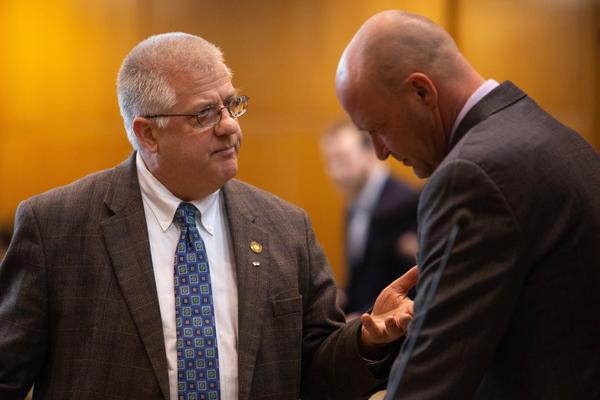 Rep Mike Nearman, R-Independence, chats with fellow representatives on the House floor on April 11, 2019, at the Capitol in Salem, Ore.