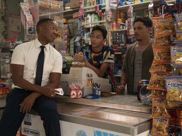 Benny (Corey Hawkins), Sonny (Gregory Diaz IV) and Usnavi (Anthony Ramos) chat in Usnavi's Washington Heights bodega<em>.</em>