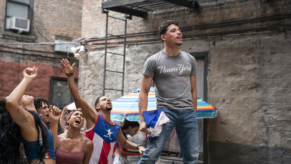 Usnavi (Anthony Ramos) runs a corner bodega and dreams of returning to the Dominican Republic in <em>In the Heights</em>.