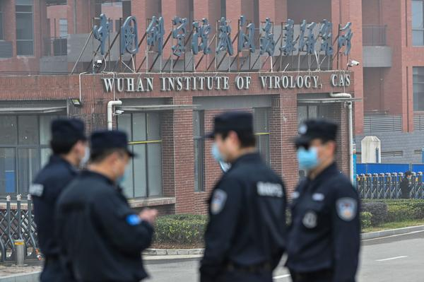 Security personnel stand guard outside the Wuhan Institute of Virology during the Feb. 3 visit of the World Health Organization team investigating the origins of the SARS-CoV-2, the virus that triggered a pandemic.