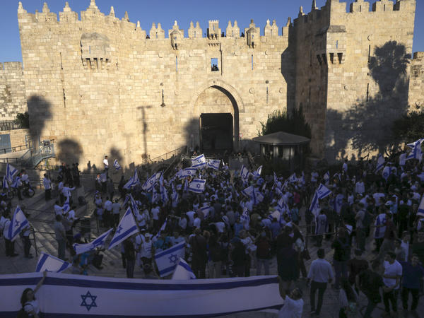 Jewish ultranationalists take part in a flag-waving march Tuesday next to the Damascus Gate, outside Jerusalem's Old City.