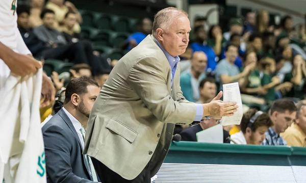 USF men's basketball associate head coach Tom Herrion is reportedly the subject of an independent investigation for allegedly making 'racially charged' comments.