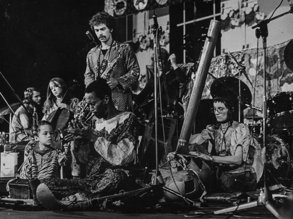 Don Cherry (center) and Moki Cherry (right) reflected their globalist attitudes towards music with international musicians and instruments. Their son, Eagle-Eye, is seated out front.