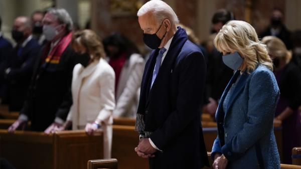 President Biden and his wife, Jill Biden, attend Mass at the Cathedral of St. Matthew the Apostle during Inauguration Day ceremonies in Washington, D.C.