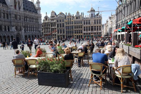People enjoy the May sunshine from the cafe terraces of Brussels' Grand Place. On Friday, European Union added the United States to the list of countries whose citizens and residents should be allowed to travel freely within the bloc.