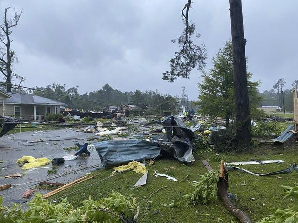 This photo provided by Alicia Jossey shows debris covering the street in East Brewton, Ala., on Saturday, June 19, 2021. Authorities in Alabama say a suspected tornado spurred by Tropical Storm Claudette demolished or badly damaged at least 50 homes in the small town just north of the Florida border.
