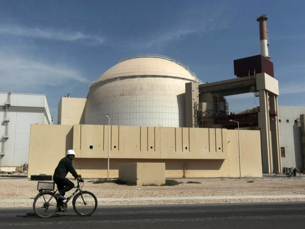 In this 2010 file photo, a worker rides a bicycle in front of the reactor building of the Bushehr nuclear power plant, just outside the southern city of Bushehr. Iran's sole nuclear power plant has undergone a temporary emergency shutdown, state TV reported on Sunday.
