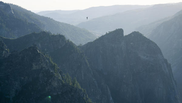 Moises Monterrubio walks a highline 1,600 feet in the air at Yosemite National Park in June. The line stretched 2,800 feet, setting a record in Yosemite and in California, according to the International Slackline Association.