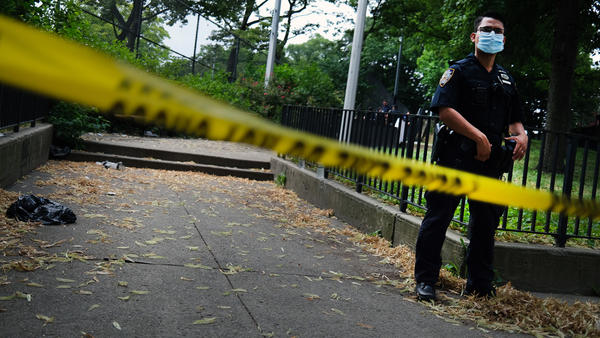 A police officer stands near the scene of a fatal afternoon shooting in the Brooklyn borough of New York City in 2020.