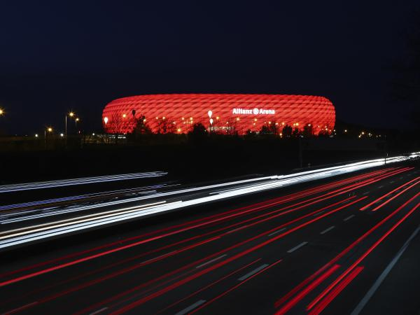 In a photo from March of last year, cars pass the illuminated Allianz Arena soccer stadium in Munich, Germany. UEFA has denied a request by the stadium to light up in rainbow colors Wednesday to protest a new Hungarian law seen as homophobic.