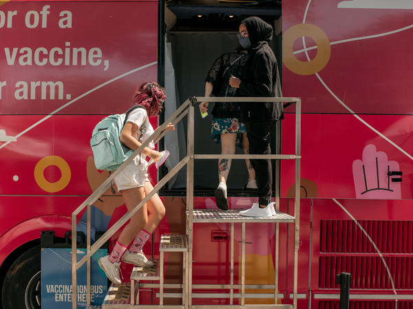 A teenager enters a pop-up COVID-19 vaccine site this month in the Jackson Heights neighborhood of Queens in New York City.