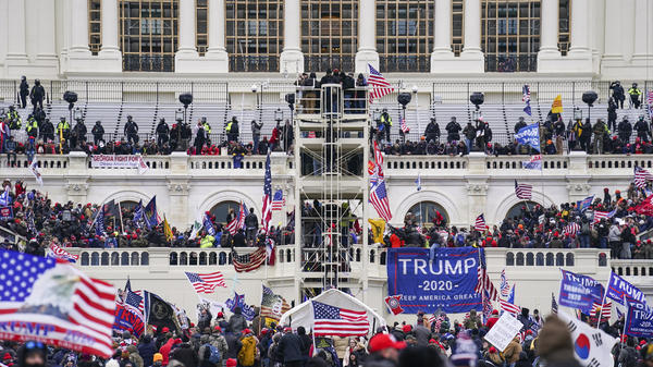 Insurrectionists loyal to former President Donald Trump breach the U.S. Capitol in Washington on Jan. 6. Prosecutors have secured the first guilty plea in a conspiracy case brought against members of the Oath Keepers extremist group in the attack.