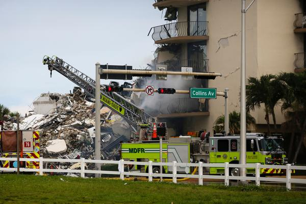 A Miami-Dade Fire Rescue truck is seen Thursday in front of debris from the partially collapsed Champlain Towers South complex in Surfside, Fla., north of Miami Beach.