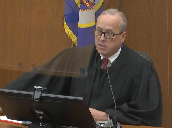 Hennepin County, Minn., Judge Peter Cahill presides over the sentencing of former Minneapolis police officer Derek Chauvin on Friday. He sentenced Chauvin to 22 1/2 years in prison for George Floyd's murder.