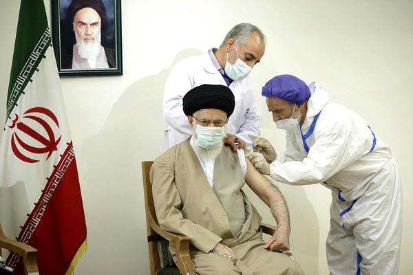 Supreme Leader Ayatollah Ali Khamenei receives a shot of COVIran Barekat, an Iranian-produced COVID-19 vaccine, in Tehran on Friday.