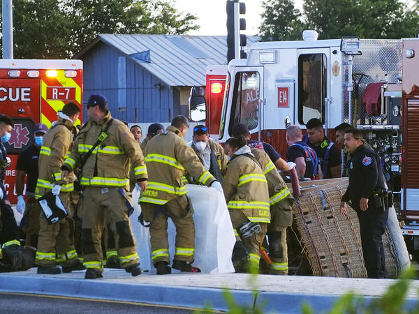 Albuquerque Fire Rescue crews work on victims of the fatal balloon crash at Unser and Central SW in Albuquerque, N.M., on Saturday, June 26, 2021.