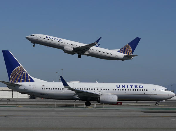 A United Airlines plane takes off over another plane on the runway at San Francisco International Airport last year. United Airlines has announced a new order of 270 narrow-bodied planes from Boeing and Airbus.