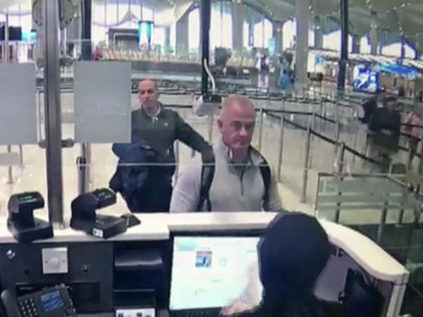 This Dec. 30, 2019 image from security camera video shows Michael L. Taylor, center, and George-Antoine Zayek at passport control at Istanbul Airport in Turkey. Taylor and his son Peter, are charged in Japan with helping Nissan's former chairman, Carlos Ghosn, jump bail and escape Japan for Lebanon.