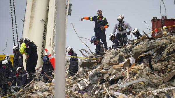 Crews work in the rubble of Champlain Towers South in Surfside, Fla.