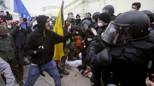 Supporters of Donald Trump try to break through a police barrier Jan. 6 at the U.S. Capitol. The House of Representatives is set to take up legislation Wednesday to create a select committee to investigate the insurrection.