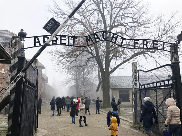"""The front gate of the former Auschwitz death camp, now a museum, reads <em>Arbeit macht frei, </em>""""Work sets you free."""" More than 2 million people visit the Auschwitz museum each year."""