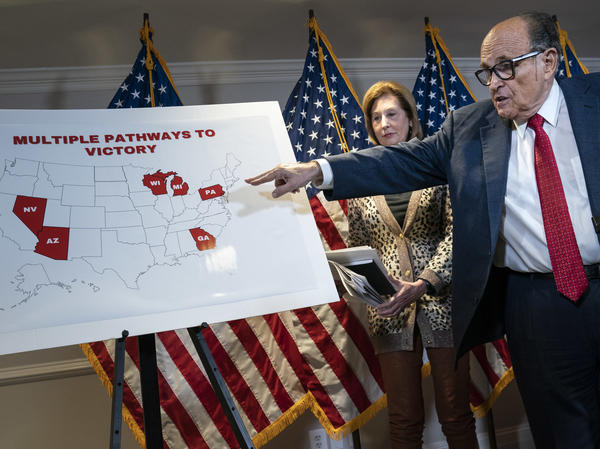 President Trump's lawyer Rudy Giuliani points to a map Thursday while speaking to the press about lawsuits related to the 2020 election at the Republican National Committee headquarters in Washington, D.C.