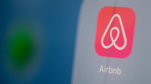 Airbnb is listing shares of its initial public offering Thursday, capping a tumultuous year for the short-term rental company.