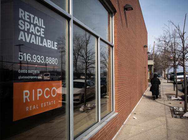 """A """"Retail Space Available"""" sign is displayed in the window of a closed JPMorgan Chase & Co. branch in the Bronx borough of New York City on Feb. 22, 2019. Banks have been closing branches, a trend that has accelerated during the pandemic as more people manage their accounts online."""