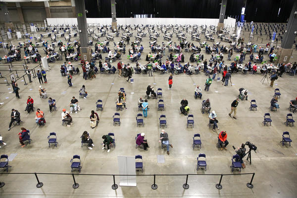 """A mass vaccination site at the Lumen Field Event Center in Seattle had plenty of takers for the COVID-19 vaccine when it opened in mid-March. Though some relatively rare cases of coronavirus infection have been documented despite vaccination, """"I don't see anything that changes our concept of the vaccine and its efficacy,"""" says Dr. Anthony Fauci of the National Institutes of Health."""