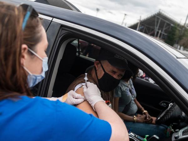 A nurse administers a COVID-19 vaccine in Ridgeway, Va., in March.