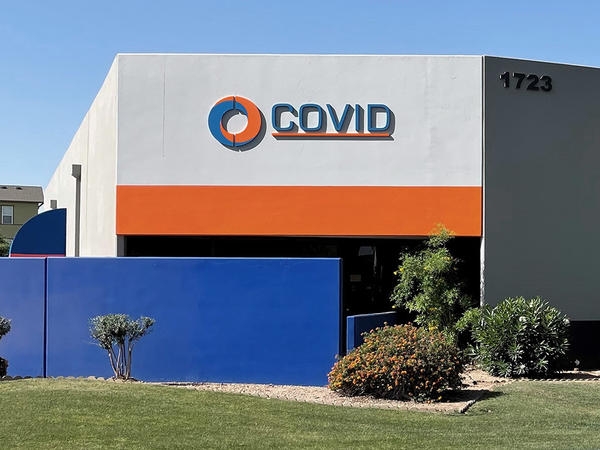 Covid Inc. in Tempe, Ariz., has been selling audiovisual equipment for decades. CEO Norm Carson says people sometimes come in to the building looking for a COVID-19 test.