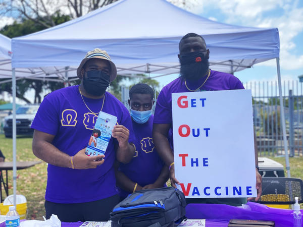 Sean Bryant, Cyrus Clark III and Xavier Mackey, members of the Omega Psi Phi Fraternity Inc., came out to recruit Black residents to get vaccinated at an event in Miami Gardens on May 8.