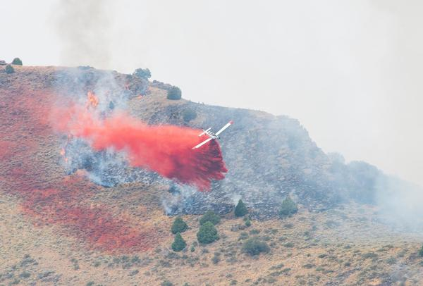 A single engine airtanker (or SEAT) drops fire retardant over a portion of the Badger Fire in Idaho on Sept. 26, 2020.