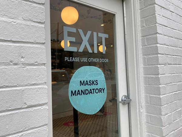 Some businesses, including Jeni's Splendid Ice Creams, are still requiring customers to wear masks indoors, despite new guidance from the CDC that it's safe for fully vaccinated people to go without them.
