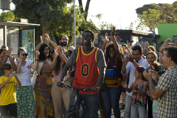 Giuseppe Dave Seke (center) plays a superhero who helps save his neighborhood from gentrification in Netflix's Italian-language series <em>Zero</em><em>.</em> It's Italy's first TV series with a predominantly Black cast.