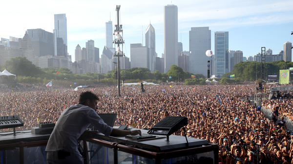 Electronic artist Flume performs at Lollapalooza in 2016. The festival is set to return at full capacity this summer.